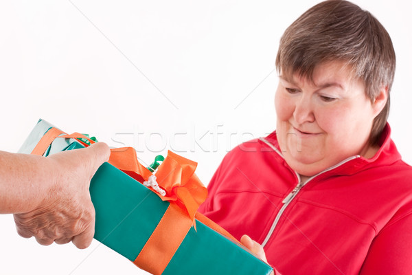 disabled woman receives gift from senior Stock photo © Pasiphae
