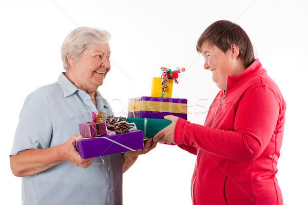 senior and mental disabled woman holding gifts Stock photo © Pasiphae