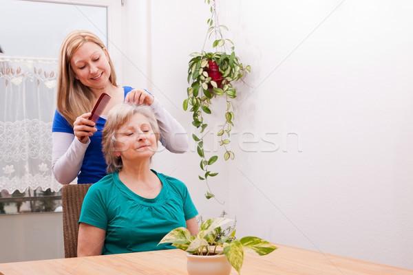 young woman combing seniors hair Stock photo © Pasiphae