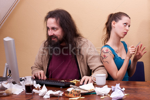 Long haired nerd on the computer with  beautiful woman Stock photo © Pasiphae