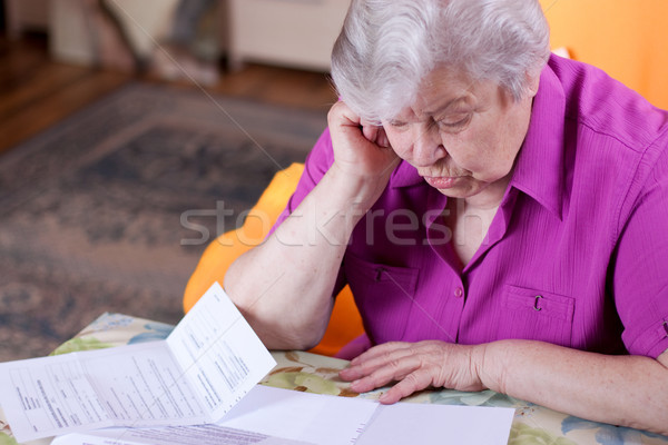 Senior reads papers and works hard Stock photo © Pasiphae