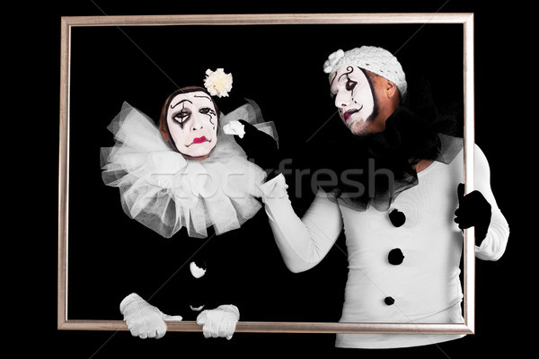 two clowns in a frame, one looks sorrowful Stock photo © Pasiphae