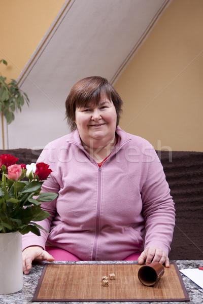 Zdjęcia stock: Niepełnosprawnych · kobieta · zabawy · domu · róż · portret