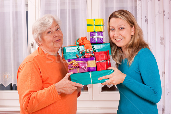 old and young woman holding presents Stock photo © Pasiphae