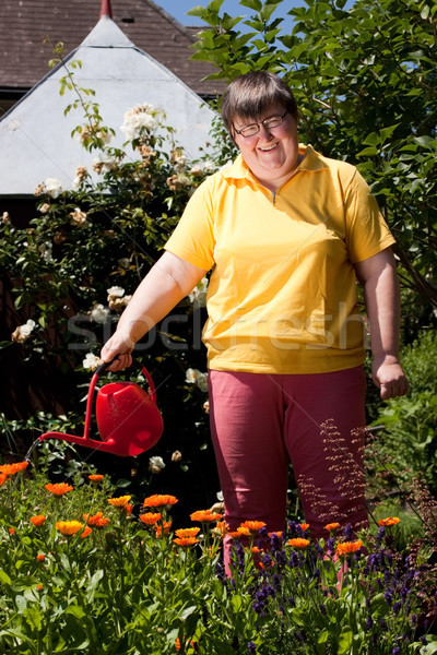 disabled woman with a  pot pours flowers Stock photo © Pasiphae