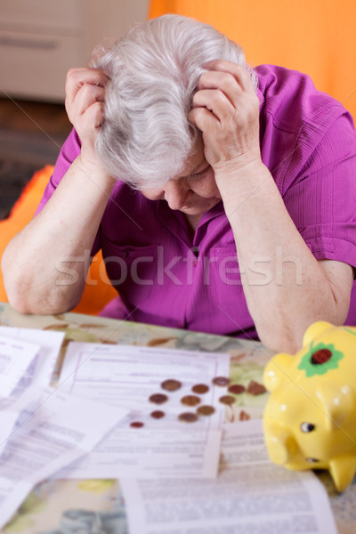 Stock photo: Elderly woman has need of money