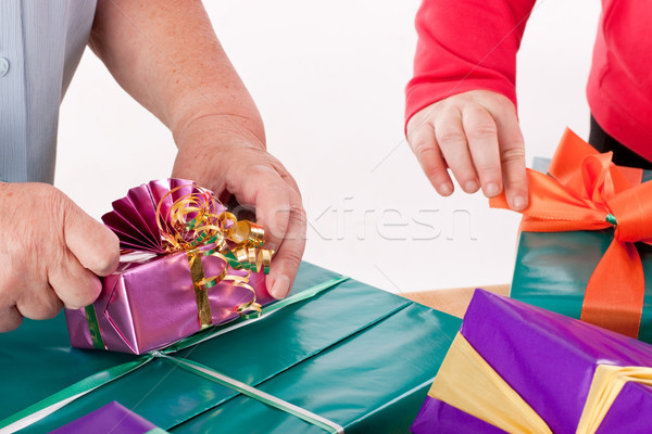 two women wrap or unpack gifts Stock photo © Pasiphae
