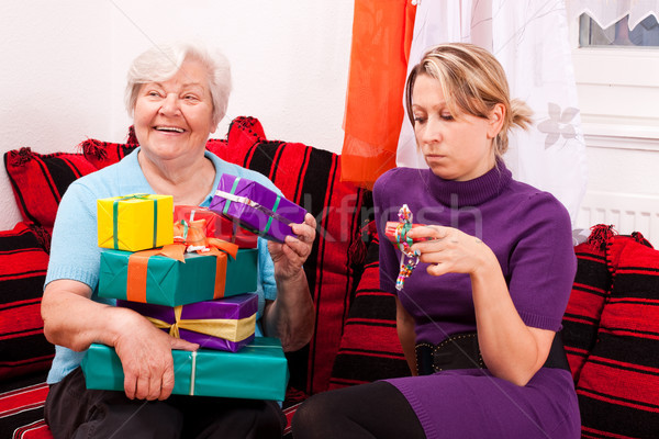 женщины старший подарки представляет молодые блондинка Сток-фото © Pasiphae