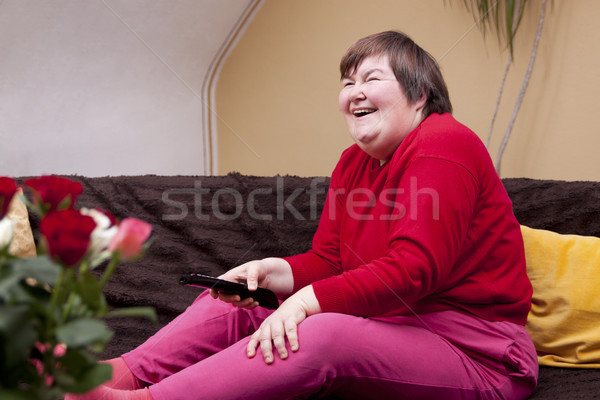 Mentally disabled woman watching television and enjoys Stock photo © Pasiphae