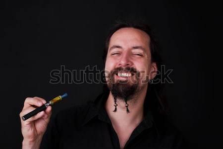 человека курение электрических сигарету стороны улыбка Сток-фото © Pasiphae