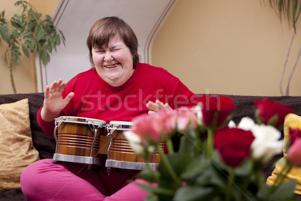 Mentally disabled woman plays drum Stock photo © Pasiphae