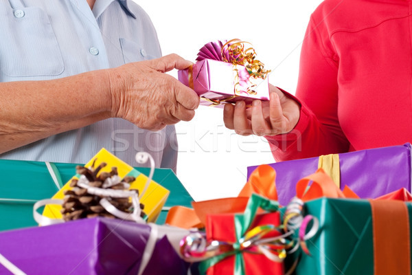 senior and daughter reaching gift to each other Stock photo © Pasiphae