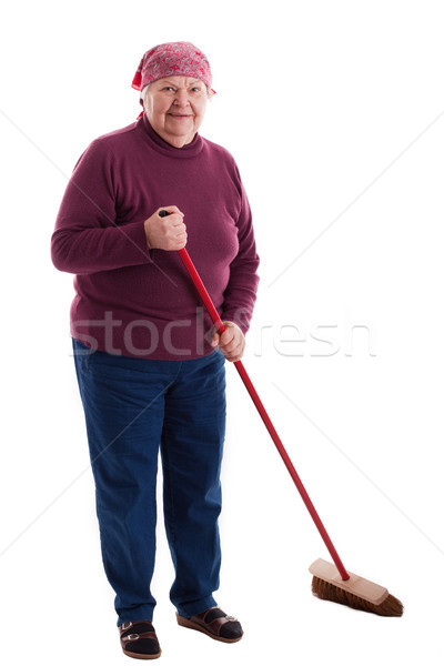 Senior sweeps the floor Stock photo © Pasiphae