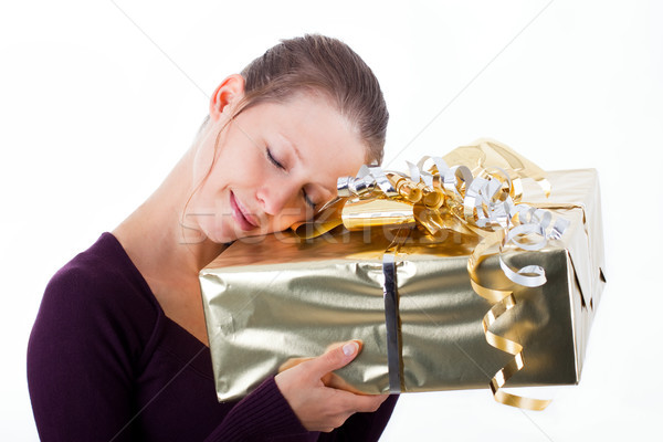 Attractive woman with golden package Stock photo © Pasiphae