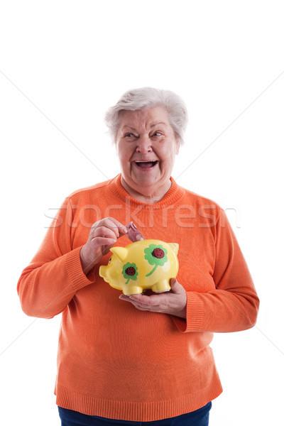 Senior halten Sparschwein alte Frau Einsparungen Feld Stock foto © Pasiphae
