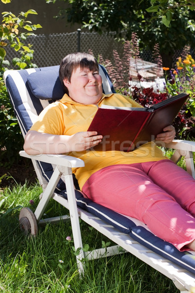 disabled woman reading a book in the garden Stock photo © Pasiphae