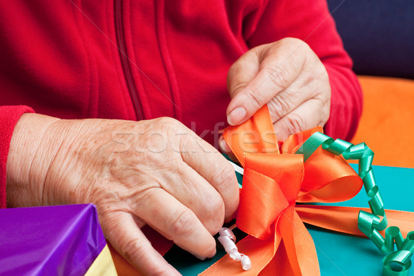 senior citizen wrap or unpack gifts, closeup Stock photo © Pasiphae