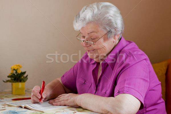 Senior puzzles with the help of reading glasses Stock photo © Pasiphae