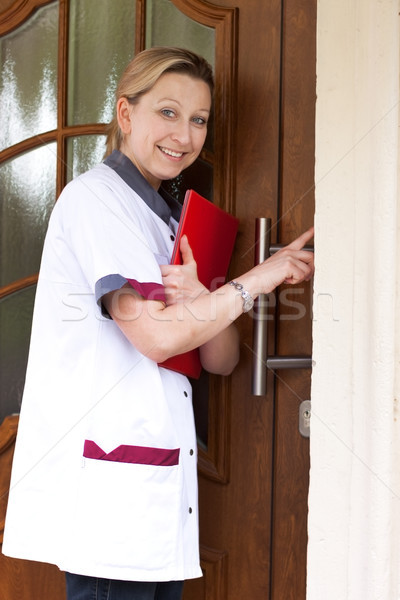 nurse at the door for home visit Stock photo © Pasiphae