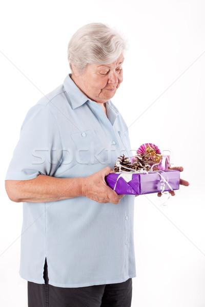 female senior with some gifts, studio shot Stock photo © Pasiphae
