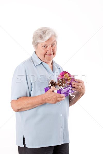 женщины старший стоять подарки представляет Сток-фото © Pasiphae