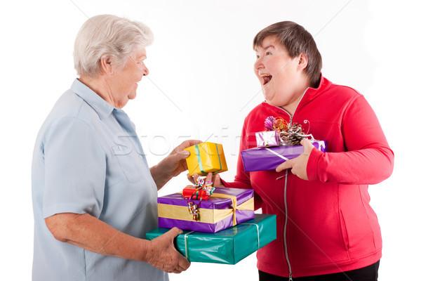 Idős szellemi mozgássérült nő tart ajándékok Stock fotó © Pasiphae