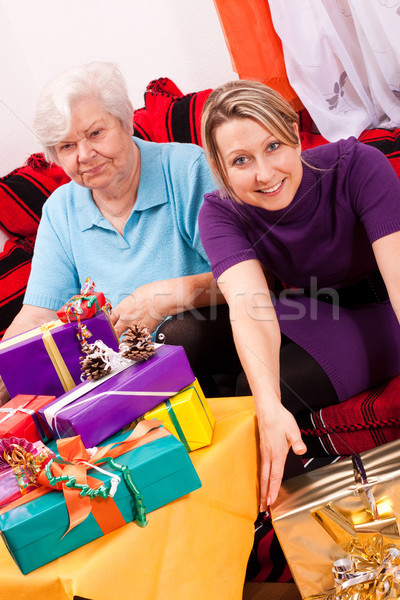 female senior and pretty daughter become a lot of gifts Stock photo © Pasiphae