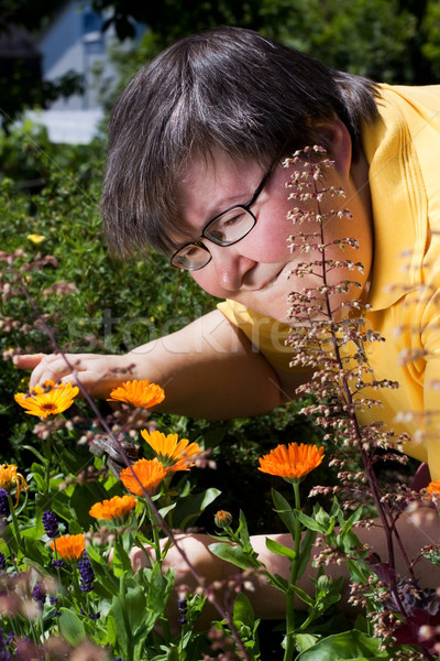 disabled woman cuts flowers in the garden Stock photo © Pasiphae