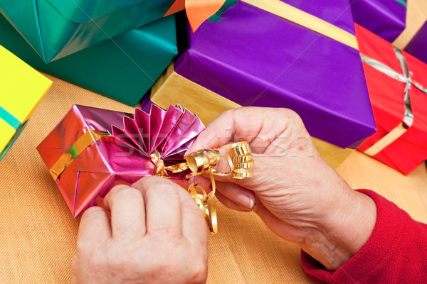 senior citizen wrap or unpack presents, closeup Stock photo © Pasiphae
