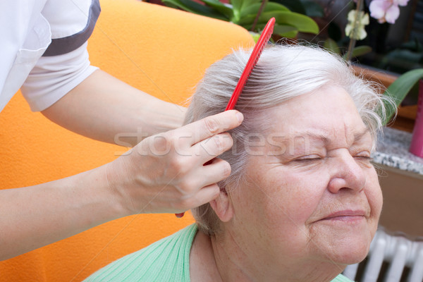 nurse combing senior through her hair Stock photo © Pasiphae