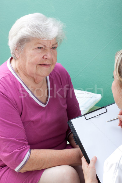 senior with female doctor and clipboard Stock photo © Pasiphae