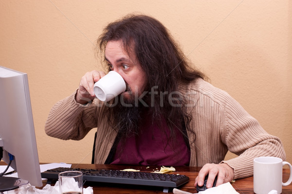long haired man at dirty desk Stock photo © Pasiphae