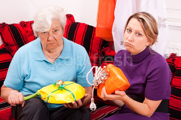 old and young woman getting loveless gifts Stock photo © Pasiphae