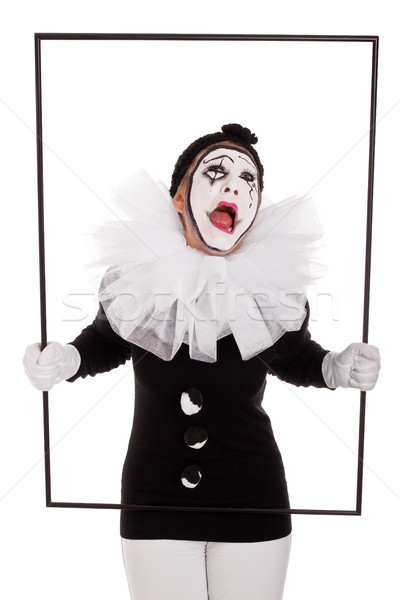 a female clown in a frame is crying Stock photo © Pasiphae