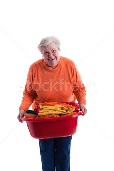 Supérieurs panier à linge vieille femme vêtements Photo stock © Pasiphae