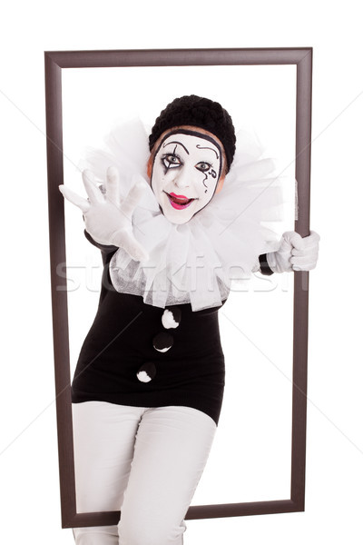 female pierrot in a frame reaching hand to viewer Stock photo © Pasiphae