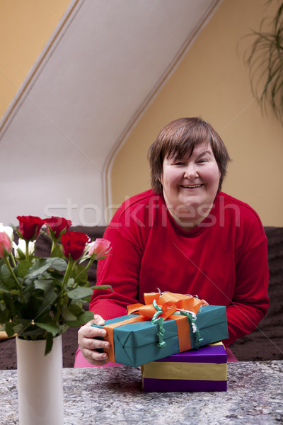 Mentally disabled woman holding many gifts Stock photo © Pasiphae