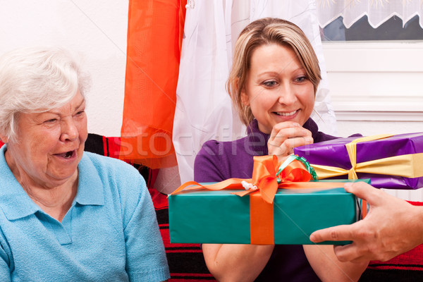 senior woman and blonde female gets presents Stock photo © Pasiphae