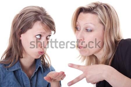 Dos enojado mujer caras hermosa jóvenes Foto stock © Pasiphae