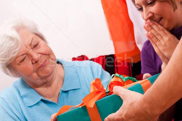 female senior gets present Stock photo © Pasiphae