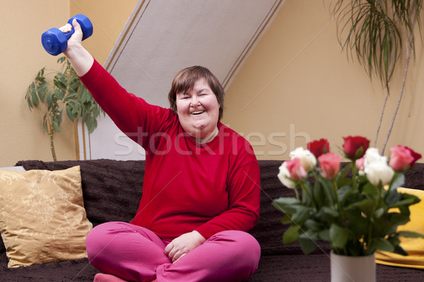 Mentally disabled woman shows her strength Stock photo © Pasiphae