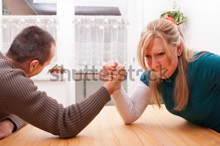 Mother and daughter fight, man keeps ears Stock photo © Pasiphae