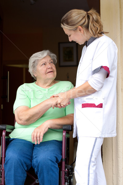 Nurse and senior patient in a wheelchair Stock photo © Pasiphae