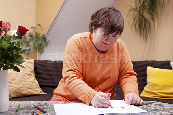 Disabled woman painted with pencils in a book Stock photo © Pasiphae