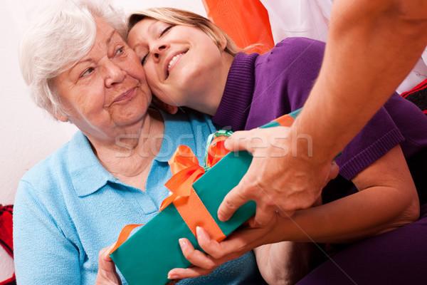 female senior gets wonderful  present Stock photo © Pasiphae
