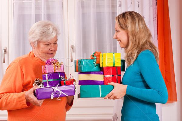 две женщины подарки другой молодые старуху представляет Сток-фото © Pasiphae
