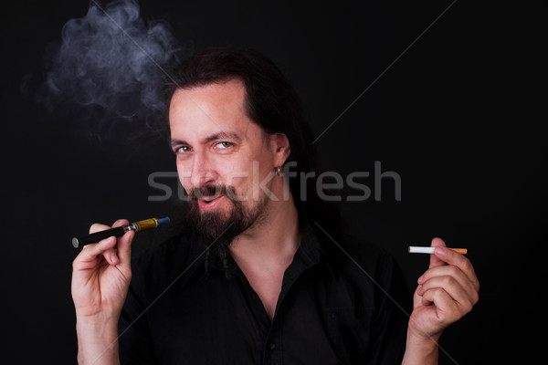 attractiv caucasion man decide to e-cigarette Stock photo © Pasiphae