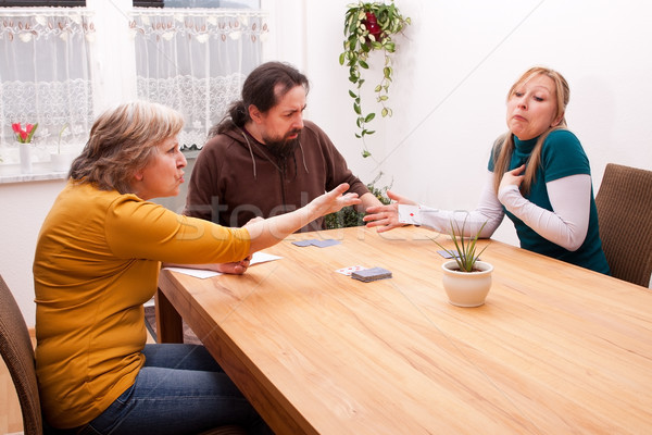 Stock photo: daughter cheating in card games with family
