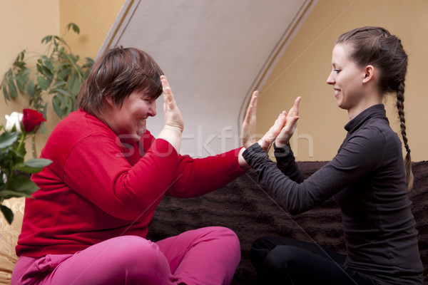 Two women making rhythm exercises Stock photo © Pasiphae