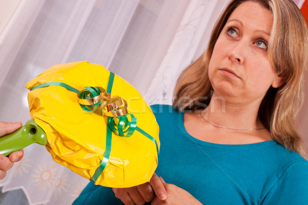 young woman gets a thoughtless gift Stock photo © Pasiphae
